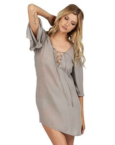 """Rayon mini dress 3/4 length bell sleeve Lace up neck Length: 34"""" Sleeve: 17"""" Bust: 18.5"""" Model is wearing size Small RESPONSIBILITY All of Cleobella's product"""
