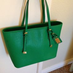 ALDO Spring Green Tote Handbag Saffiano leather Inside zipper compartment and pockets. Matching hang tag adorns the front.  Nice and roomy. Great for Spring. Used once and gently stored. Excellent condition. Compare to Michael Kors tote without the price tag. No trades ALDO Bags Totes