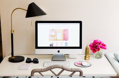 Feminine workspace/desk with modern lamp and faux bamboo chair