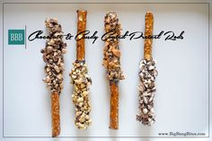Chocolate & Candy Coated Pretzel Rods | Big Bang Bites | bigbangbites.com | Salted pretzel rods dipped in dark chocolate and coated with crushed candy bars and peanuts.