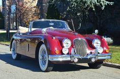 1958 Jaguar XK150 Drophead Convertible burgundy with tan interior. This car is in excellent condition and is mechanically very sound. For only $56,500.