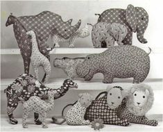 """AFRICAN SILHOUETTE ANIMALS Includes Adult Giraffe - 10½"""" and Baby Biraffe- 8"""" tall by Colette Wolff of Platypusnow  Easy to make pillow toys: six mammals—Rhino, Elephant, Giraffe, Hippo, Camel, Lion; six babies (same), and one papa Lion  Sample sizes:  large Hippo―6"""" x 11"""" small Hippo―3¼"""" x 6¾"""" large Giraffe―10½"""" tall small Giraffe―8"""" tall Booklet contains full-size patterns and detailed, illustrated instructions.  Cut body casings for all mamas, all babies, and one papa from appropriate…"""