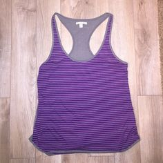 American Eagle racerback tank Large American Eagle racerback tank navy and fuchsia striped front with grey trim. Back is solid grey. Fits loose - super comfortable and soft! Only worn a few times. 85% polyester 15% linen. American Eagle Outfitters Tops Tank Tops