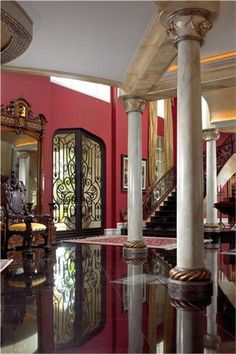 Looking For A Grand Entrance? How About That Door and The Columns.