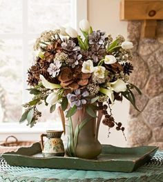 awesome Fashion these woodsy, late-winter floral displays with pinecones from your own backyard for truly seasonal, and locally sourced, arrangements. CONTINUE READING Shared by: Winter Floral Arrangements, Flower Arrangements, Pinecone Bouquet, Centerpiece Decorations, Wedding Decorations, Christmas Decorations, Wedding Ideas, Flower Petals, Pine Cones