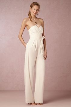 Wedding pants and jumpsuits are becoming a trend in the wedding world. We love the clean and sophisticated style of this adorable wedding jumpsuit.