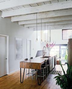 dwell island stools. Whitewash exposed joist ceiling.