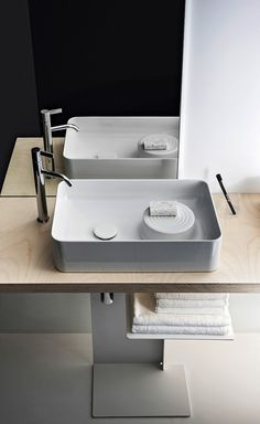 Patented by Swiss manufacturer Laufen, SaphirKeramik is a super-strong ceramic material that can be shaped into impossibly thin geometric forms (think porcelain without the fragility). Laufen brought Munich-based designer Konstantin Grcic on board. Laufen Bathroom, Bathroom Spa, Bathroom Toilets, Modern Bathroom, Bad Inspiration, Bathroom Inspiration, Bathroom Styling, Bathroom Interior Design, Reece Bathroom