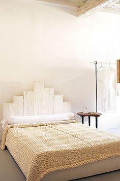 White painted wood headboard; Katrin Arens