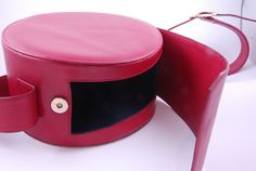 1960's Red Leather Round Shoulder Bag | From a collection of rare vintage handbags and purses at https://www.1stdibs.com/fashion/accessories/handbags-purses/
