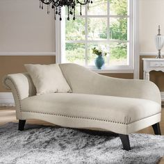 @Overstock - This Phoebe designer chaise lounge from Baxton Studio features accents of silver upholstery tacks, a throw pillow, foam cushioning, and beige linen upholstery. Non-marking feet finish off the black wood legs. http://www.overstock.com/Home-Garden/Baxton-Studio-Phoebe-Beige-Linen-Modern-Chaise-Lounge/7564671/product.html?CID=214117 $614.99