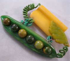 RARE 1920s 30's Bakelite Pea Pod Vegetable Brooch Pin Hand Carved Large Peapod. $375.00, via Etsy.