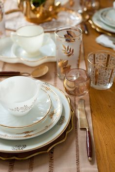 white, grey and gold dish set. It looks so pretty with the mixed gold trimmed glasses.