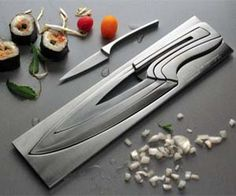 A set of Modern Knives Set that will enhance your kitchen! These knives comes in a set of 4! It's made of high quality stainless steel. The set seemingly appears to be created from a single block of stainless steel! Genius!