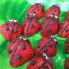 Irresistible! Chocolate Strawberry Lady Bugs - simply cut strawberries in half, lay flat on a plate that has been covered in green icing, or simply covered with lettuce leaves, paint or pipe chocolate lines and dots - EASY! #Voilá!