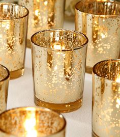 Wedding Decoration Votive Candle Holder in Gold. Wedding decorations that add a stunning look to your wedding table décor. David Tutera™ mercury glass votive candle holders in spotted gold. 12 votives per pack. Perfect addition to your wedding reception tables, party decorations or holiday decor.