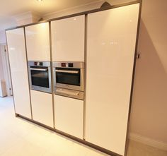 White and Pewter Gloss Kitchen with Purple metallic glass, and a stunning extractor. Designed and Supplied by KITCHENCRAFT Witham, Essex.
