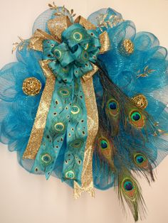 Deco Mesh Wreath,Peacock Feathers, Spring Summer Deco Mesh Wreath, Door Wreath, Elegant Wreath, Turquoise Deco Mesh Wreath, Large Bow, by BeautifulHomeAccents on Etsy https://www.etsy.com/listing/179240587/deco-mesh-wreathpeacock-feathers-spring