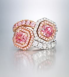 A pair of colored diamond rings with 1.20-carat fancy intense purplish-pink and 1.21-carat fancy-intense pink diamonds