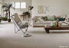 Dit #interieur met kamerbreed #tapijt is een plek om op adem te komen. Desso Studio Nature