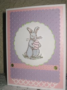New Easter Card ~I stamped the bunny on the scallop circle, then stamped another one, cutting it out, and using a 3D Foam Square on top.   I used a Bunny Rubber Stamp (Northwoods Stamps Inc.), Stampin-Up Perfect Polka Dots Embossing Folder, Stampin-Up Dotted Scallop Ribbon Border Punch, and a Martha Stewart Border Punch.  Copic markers were used for the bunny.
