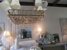 Welcome to Glory B's Cottage....: stealing this idea ~ rusty bed frame twinkling lights and lampshades = LOVE