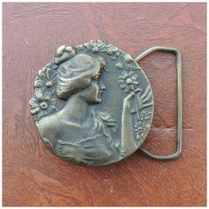 Vtg 70s Art Nouveau Revival Belt Buckle // Bergamot Brass Works Gibson Girl Brass Buckle by byHEXEREI on Etsy https://www.etsy.com/listing/177944300/vtg-70s-art-nouveau-revival-belt-buckle