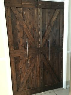Bifold barn door done for the pantry.  Stainless steel hardware adds a touch of modern with the rustic style.  Customized order:  email Amatore Wood Design, Hollywood, Fl jyvconstruccion@gmail.com