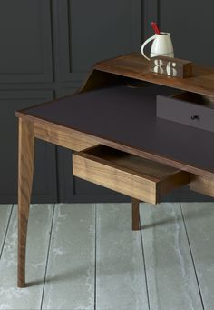 The Yves desk has an inlaid leather writing surface, two drawers (the top one colour matched to the leather) and a covered cable access hole on the left hand side.