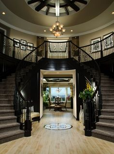 Double staircases and a view to the dining make a dramatic entry.