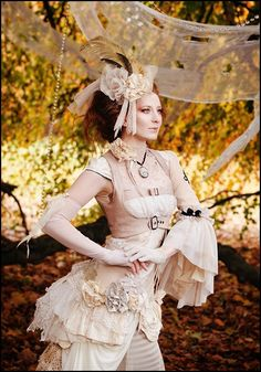I love the big sleeve -end- on the right, the pastel pink colour of the fabric, the headpiece and the use of lace, also the decoration techniques.