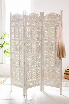 8 Bohemian Must-Haves From Urban Outfitters Right Now on domino.com (love this carved screen!)