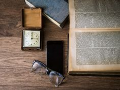 #book #clock #desk #eyeglasses #iphone #knowledge #pages #smartphone #table #text #time #watch #wood
