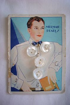 "(::)  vintage ""Mermaid Pearls"" button card (from Hawkeye Button Co., established 1903) In Muscatine, Iowa.  Gotta' love a well-read man with a book in his hand!  His arm appears a bit out of proportion, but I love old-fashioned  graphics on antique products."
