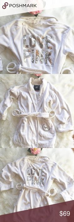 """💗PINK VS WHITE COZY ROBE W/ BIG SEQUIN LOGO💗 💗ADORABLE AND GORGEOUS AND WARM AND SOFT AND COMFY!! THICK, THICK TERRY WITH SILVER DOGGY CREST ON FRONT POCKET AND HUGE """"LOVE PINK"""" IN SILVER SEQUINS ON BACK. NEW $328!! EXCELLENT CONDITION WITH A FEW MINOR FLAWS (SEE PIC 7) SMALL TAREON BACK, A FEW SMALL SPOTS UNDERNEATH ARM (TOO LIGHT FOR CAMERA TO CAPTURE. OVERALL IT'S A BEAUTY! IT'S TOO HOT IN FL. TO WEAR. MINI LENGTH, NO MISSING SEQUINS, BELT, ROBE HOOK. WARN & COZY! GREAT FOR ANY PINK…"""