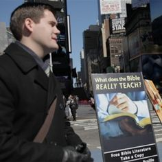 One of Jehovah's Witnesses with a Bible literature display. Can't wait to see in Manhattan!