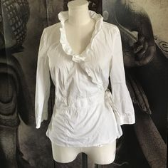 ❄️❤️HOLIDAY SPECIAL❤️❄️ NWOT Ruffle Neck Wrap Top Cotton top perfect for the summer! Cute ruffle collar and wrap belt by Ann Taylor. Ann Taylor Tops Blouses