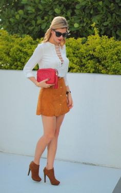 """{ """"IT"""" Skirt }  Suede button up camel skirt paired with a laced up or caged up white top with gucci red disco bag and camel booties. Henri Bendel ear cuff.  Quay Australia black sunglasses and daniel wellington leather strap watch. For  all seasons short hair style"""