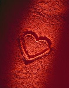 Beautiful Red heart on the sand. The countdown to Valentine's day has started.