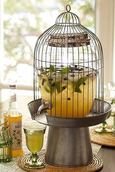 This Pottery Barn bird cage drink dispenser stand is amazing. Definitely going to own this someday.