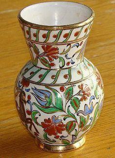 Here is a vividly decorated Ikaros pottery vase hand painted in Rhodes Greece. The raised polychrome design includes red, green, blue and gold in a Greek Pottery, Pottery Vase, Ceramic Vase, Rhodes, Holiday Travel, Tablescapes, Vases, Deer, Greece