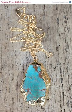 A piece of turquoise is rimmed with 24k gold vermeil and hangs from a beaded 14k gold filled chain. This is a great summer necklace and