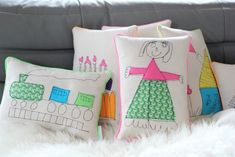 Pillows embroidered with children's drawings - love!