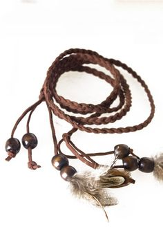 Necklace made of feather and knitting,featuring feather and bead pendant with knitting band, all in fashion style design.$15