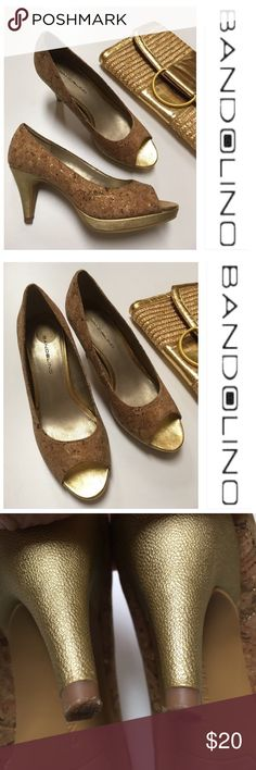 "BANDOLINO Mylah Platform Pump Cork & Gold Size 6 These pretty pumps were worn once. Have some glue residue on inside from manufacturing process. Has sticker glue residue also. No box. Clutch sold separately. Bandolino Women's Mylah Pumps in Cork/Gold  Heel height: 3.25"" inches. Platform 1/2"" inch. The Bandolino Mylah Pumps in Cork/Gold feature synthetic sole, leather lining, cork details, patent leather, leather upper, faux leather. Bandolino Shoes Heels"