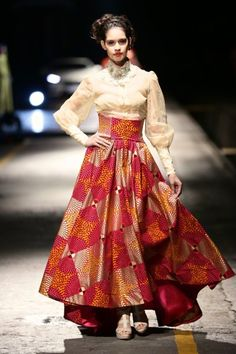 Resembles the Hanbok with ht waistline coming up under the breasts and the vibrant colors.