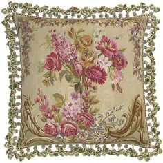 Floral Pillow, made of silk, accented with luxurious fringe and trimmed & backed with silk.