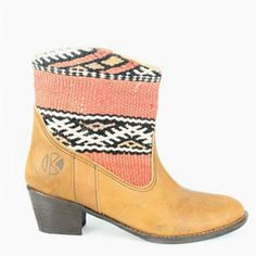 Kiboots - Inez boot.  In the 60's traveling hippies influenced Arabian artisans to combine leather and kilim rugs to make boots. Years later, Jovanna Kruitbosch and Martijn Lugtigheid serendipitously found and fell for a pair of these boots. The Amsterdam-based duo has since revitalized this craft with their handmade one-of-a-kind Kiboots.