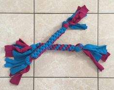 Kids recycle your old tee shirts into this sturdy woven dog toy. You'll keep them out of the landfill and make your dog happy too. This is a great project to teach kids this weaving process and also make toys to donate to your local animal shelter who are Diy Dog Toys, Pet Toys, Cat Crafts, Sewing Crafts, Animal Shelter Donations, Old Tee Shirts, Dog Training Classes, Dog Houses, Diy Stuffed Animals