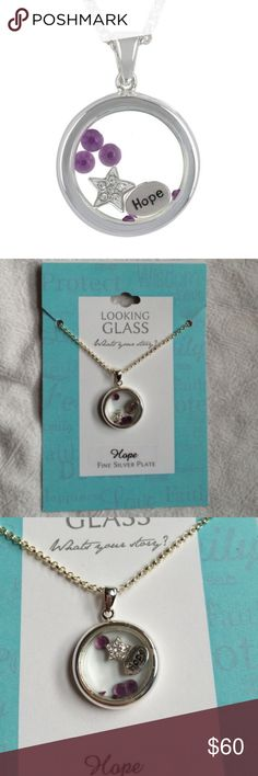 """Looking Glass Silver Plate Hope Necklace Pendant Brand: Looking Glass  Condition: Brand new with tags  Express yourself with our personalized Looking Glass charm pendant. This design features 'Hope' inspired motif and a high polish silver plate finish.  Pendant/ Chain - Silver plated looking glass with """"HOPE"""" , star with crystals inside glass   To wear for any occasion - everyday, casual, business and formal. Silver plated brass and crystal.   Size - length of chain 18"""" and pendant length…"""
